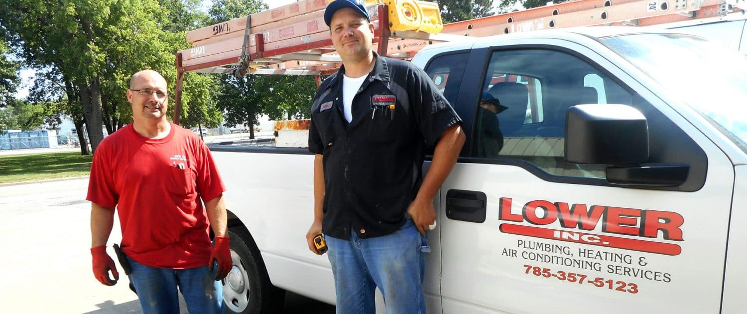 Techs gettin ready to get in the van at Lower Plumbing, Heating and Air, 501 SE 17th Street, Topka, KS 66607